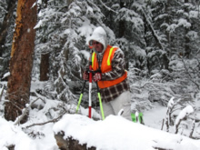 Man surveying in snow